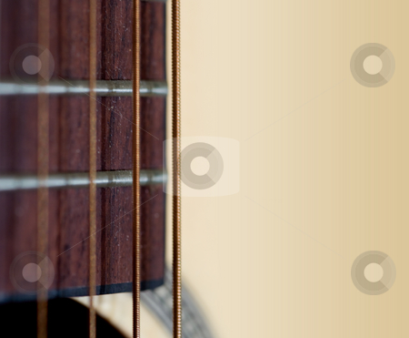 Guitar stock photo, An acoustic guitar close up , shallow DOF photo by Gordan Poropat