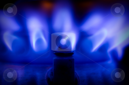 Blue gas flame stock photo, Blue gas flame on a stove by GPimages