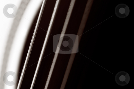Guitar stock photo, An acoustic guitar close up , shallow DOF photo , focus on string by Gordan Poropat