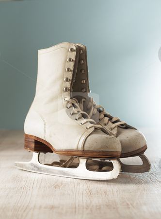 Old Skates stock photo, Old white women's ice skates on wood by Stocksnapper 
