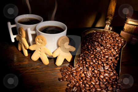 Gingerbread men and coffee stock photo, Gingerbread men and coffee by Anneke