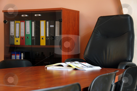 Catalog on desk in office stock photo, Opened catalog on brown wooden desk in office by Julija Sapic