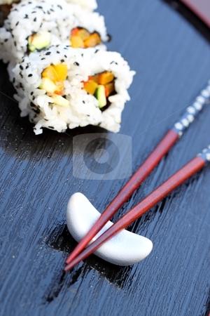 Chopsticks sushi stock photo, Healthy very popular Japanese food sushi with chopsticks by Henrik Lehnerer