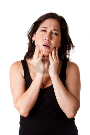 Woman with dental jaw pain stock photo, Beautiful young attractive woman with dental tooth jaw pain expression feeling unwell, holding her chin, isolated. by Paul Hakimata