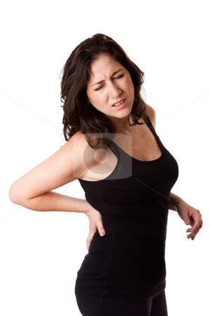 Woman with back injury stock photo, Beautiful woman holding her back with pain and ache due to injury,wearing a sporty black tank top, isolated. by Paul Hakimata