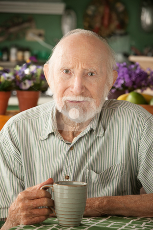 Serious senior man with mug stock photo, Serious senior man at home with coffee or tea by Scott Griessel