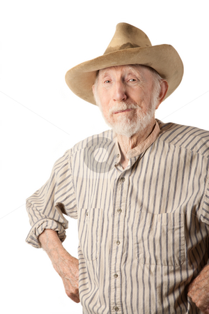 Grungy Senior Cowboy stock photo, Grungy senior cowboy with a sweat-stained hat by Scott Griessel