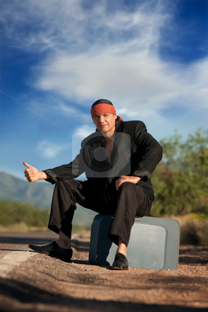 Indigenous man by the side of the road stock photo, Handsome indigenous man by the side of the road by Scott Griessel