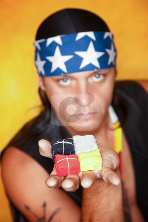 Handsome mixed race man with flag packets stock photo, Handsome mixed race man with flag packets representing four directions by Scott Griessel
