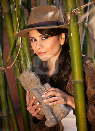 Pretty adventurer with stolen relic stock photo, Pretty adventurer with stolen relic in thick green bamboo forest by Scott Griessel