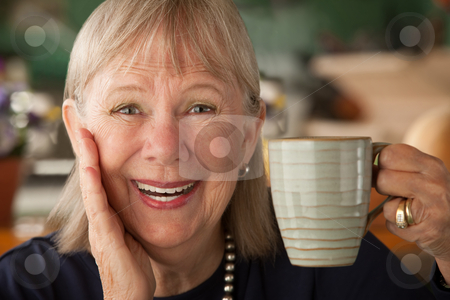 Senior woman with mug stock photo, Senior woman at home with coffee or tea by Scott Griessel