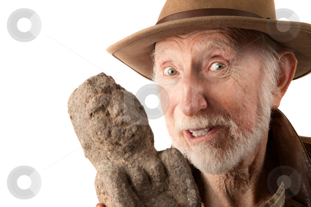 Adventurer or archaeologist with idol stock photo, Adventurer or archaeologist in brown leather jacket with idol by Scott Griessel