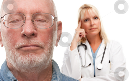 Concerned Senior Man and Female Doctor Behind stock photo, Concerned Senior Man and Female Doctor Behind with Selective Focus the Gentleman in front. by Andy Dean