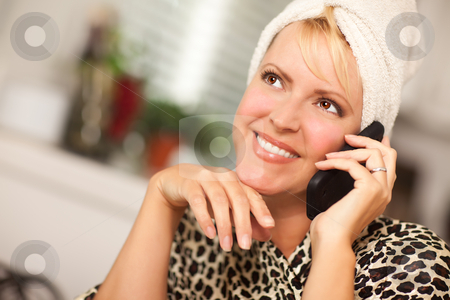 Attractive Caucasian Woman Talking on Cell Phone stock photo, Attractive Smiling Caucasian Woman Talking on Her Cell Phone. by Andy Dean