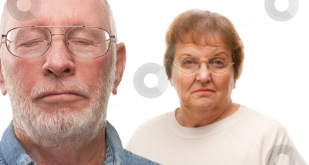 Concerned Senior Couple on White stock photo, Concerned Senior Couple with Selective Focus the Gentleman in front. by Andy Dean