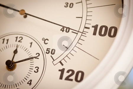Round Thermometer Showing Over 100 Degrees stock photo, Round Outdoor Thermometer Showing Over 100 Degrees. by Andy Dean