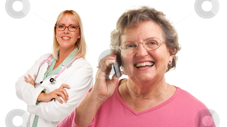 Senior Woman Using Cell Phone with Female Doctor Behind stock photo, Happy Senior Woman Using Cell Phone with Female Doctor or Nurse Behind Isolated on a White Background.. by Andy Dean