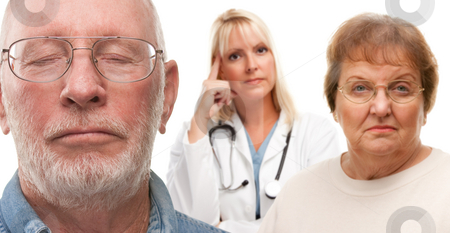 Concerned Senior Couple and Female Doctor Behind stock photo, Concerned Senior Couple and Female Doctor Behind with Selective Focus the Gentleman in front. by Andy Dean