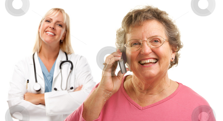 Happy Senior Woman Using Cell Phone with Female Doctor Behind stock photo, Happy Senior Woman Using Cell Phone with Female Doctor or Nurse Behind Isolated on a White Background.. by Andy Dean