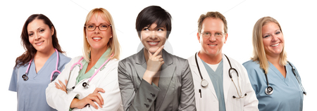 Young Multiethnic Woman with Doctors and Nurses Behind stock photo, Young Multiethnic Woman with Doctors and Nurses Behind Isolated on a White Background. by Andy Dean