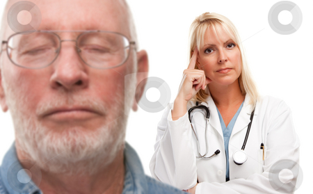 Concerned Senior Man and Female Doctor Behind stock photo, Concerned Senior Man and Female Doctor Behind with Selective Focus the Doctor. by Andy Dean