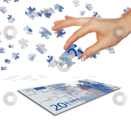 Puzzle of the euro banknotes  stock photo, Puzzle of the euro banknotes and hands which it is collected. Symbol of business by Sergey Nivens