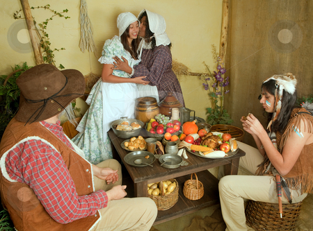 Thanksgiving in Plymouth stock photo, Reenactment scene of the first Thanksgiving Dinner in Plymouth in 1621 with a Pilgrim family and a Wampanoag Indian by Anneke