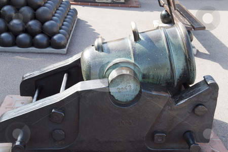 Cannon stock photo, An old bronze cannon that has tarnished by Kevin Tietz