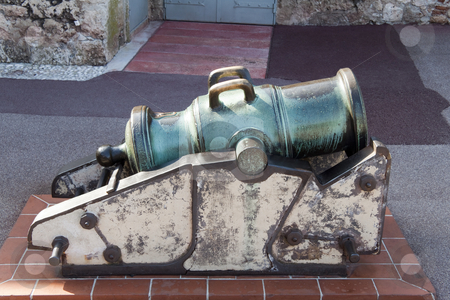 Bronze Cannon stock photo, An old bronze cannon that has tarnished by Kevin Tietz