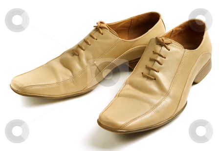 Mans beige shoes stock photo, Mans beige shoes. Isolated on a white background by Alex Varlakov