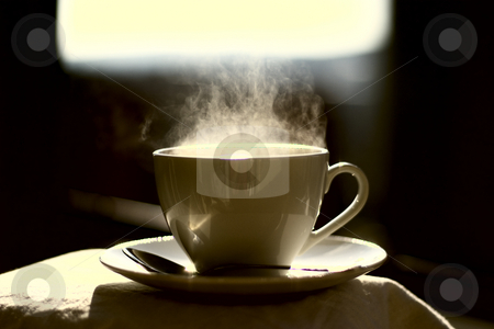 Hot coffee stock photo, Hot coffee. Little depth of field to focus on feeling the heat. Extreme colors to emphasize the idea by Alex Varlakov