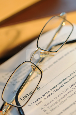 Glasses stock photo, The combined glasses lay on the textbook by Salauyou Yury