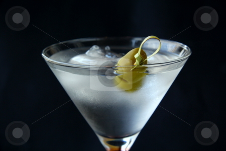 Martini cocktail stock photo, Martini cocktail glass with a black background by Olga Kriger