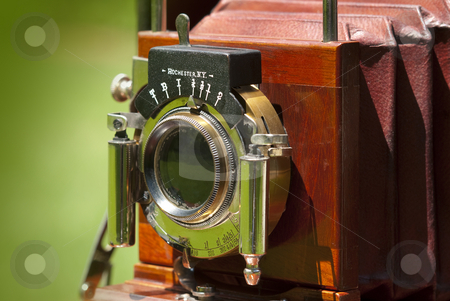 Old wood camera stock photo, Beautiful turn-of-the-century wooden view camera with red bellows by Christian Delbert