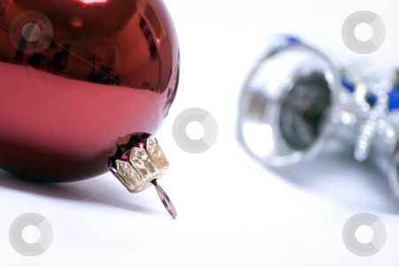 Christmas and New Year decorations   stock photo, Red Christmas ball and silver bell isolated on white background by Kirill Kedrinski