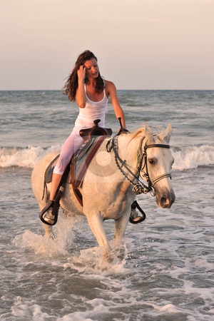 Woman and  horse in the sea stock photo, Beautifu lwhite horse in the sea and beautiful woman by Bonzami Emmanuelle