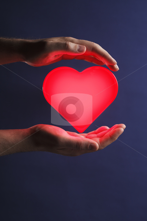 Love stock photo, Man holding a glowing red heart in his hands by Stocksnapper