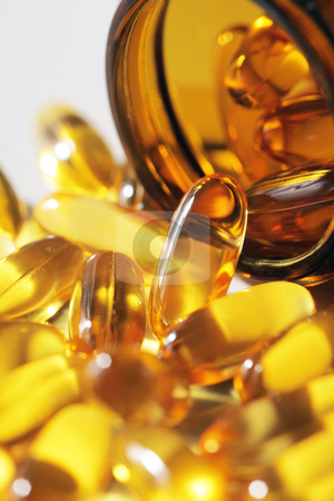 Omega-3 stock photo, Omega 3 fish oil capsules by Stocksnapper