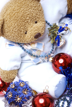 Soft bear with Christmas decorations   stock photo, Soft bear with Christmas balls, bells, flowers and  garland by Kirill Kedrinski