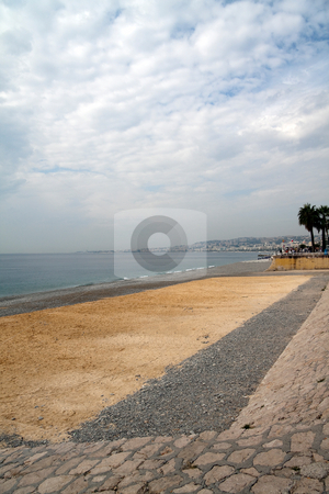 Sandy Beach stock photo, The sandy and rocky beach in Nice, France by Kevin Tietz