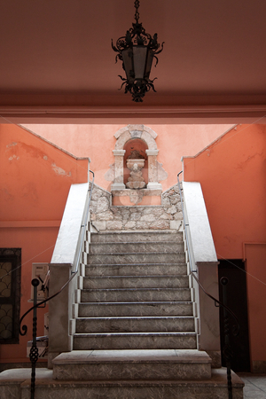 Staircase stock photo, A grand colorful staircase leading up a hill by Kevin Tietz