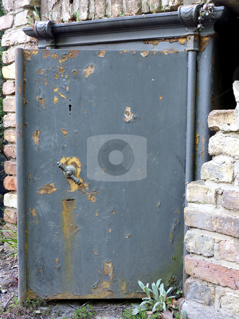 Steel Door stock photo, Door of an old safe outside from a building by Heike Jestram