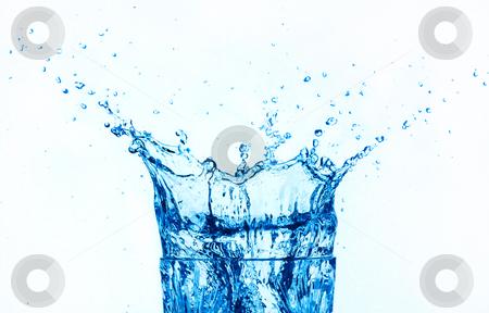 Blue water splashing isolated on white background. stock photo, Blue water splashing on glass, isolated on white background. by Pablo Caridad