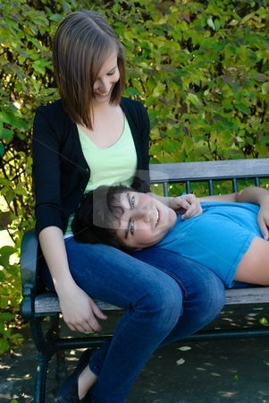 Resting Boyfriend stock photo, A young teen lying on his girlfriend's lap by Richard Nelson