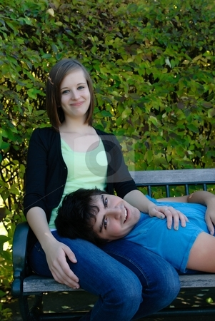 Resting Teenagers stock photo, A young couple taking a rest on a park bench by Richard Nelson