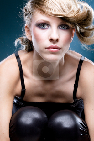 Fashion portrait of a young woman stock photo, Fashion shot of a blonde young woman with asymetricaly styled hair and black leggins by dan comaniciu