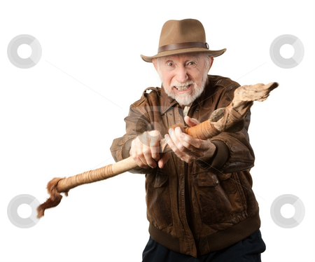 Adventurer or archaeologist defending himself stock photo, Adventurer or archaeologist in brown leather jacket defending himself with abcient weapon by Scott Griessel