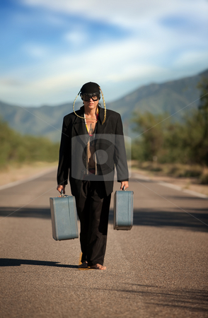 Strange indigenous man in the middle of a road stock photo, Strange indigenous man in the middle of a road with suitcases by Scott Griessel