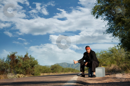 Indigenous man by the side of the road stock photo, Handsome indigenous man by the side of the road with copy space by Scott Griessel