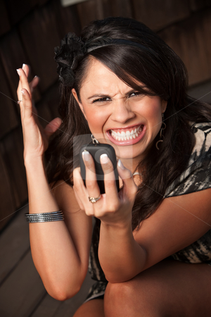 Beautiful Woman Receiving Call or Text stock photo, Beautiful Woman Receiving Call or Text on her Cell Phone by Scott Griessel